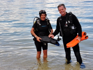 Leon and Julia head out to scuba dive from shore.