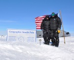 Julia and mark at the Magnetic South Pole. The residential facility is behind us and the small pole in front.