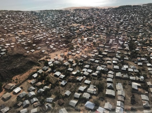 Pemba town from the air. Small, jumbled houses with tin roofs.