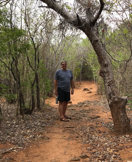 Walking through the dense forest on Quilalea Island