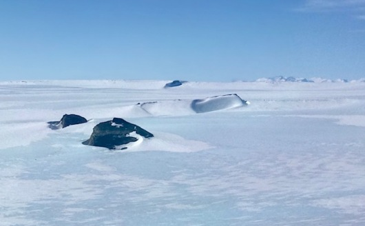 Antarctic hills and plateau as we near Wolf Fang Airport