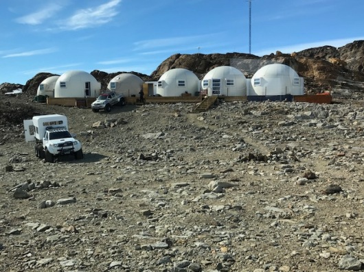 The public pods, trucks and rock walk from our pod.