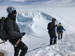 Scott, mark and Manu head out to climb the glacier.
