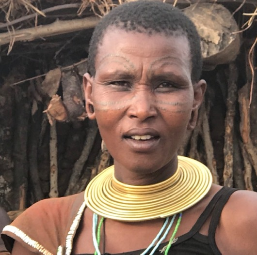 A Datoga lady with decorative scarification.